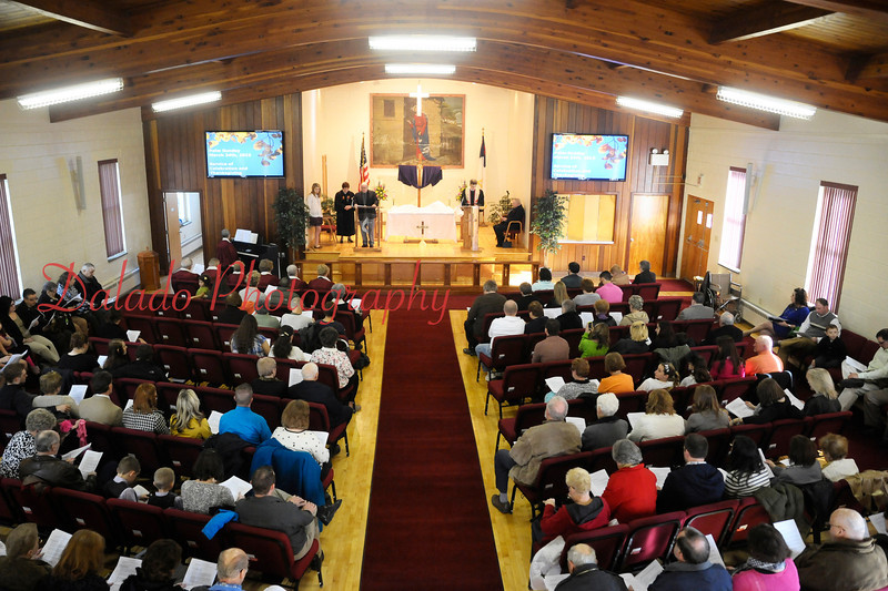 The congregation of St. John's United Methodist Church hold Palm Sunday worship service in their parish hall in Coal Township after a procession from their 103-year-old main house of worship. Sunday's worship was the last held in the church on the southeast corner of Arch Street and Eagle Avenue.