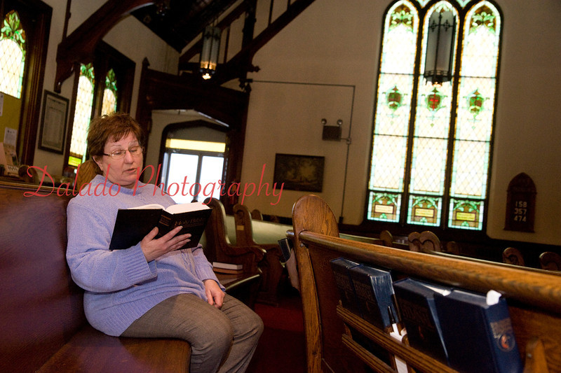 The Rev. Karyn Fisher, pastor of St. John's United Methodist Church, Coal Township, reads a scripture from the Bible.