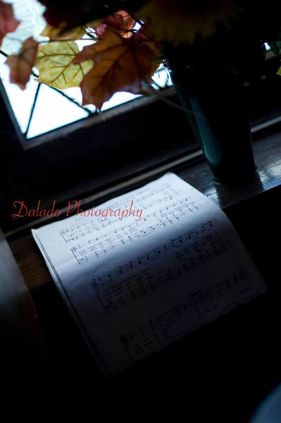 A piece of sheet music inside St. John's United Methodist Church, Coal Township, is illuminated by outside light.