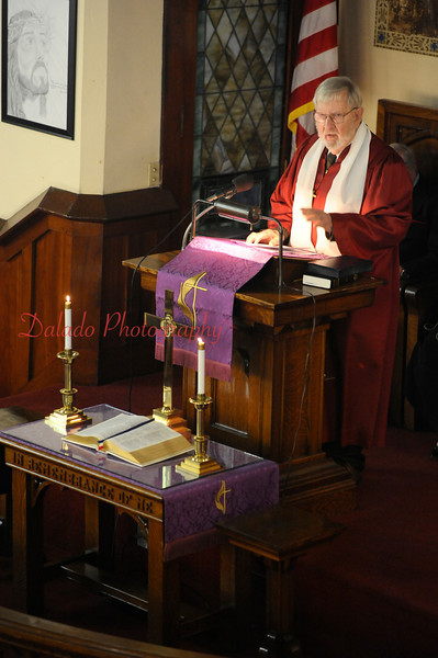 Jack Mathew, a member of St. John's United Methodist Church, speaks of the church's history during Palm Sunday service.