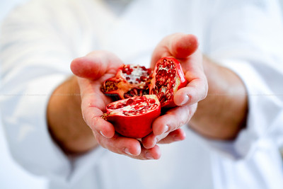 Chef holding a pomegranate