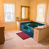 White Quilt Room Jacuzzi Tub