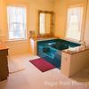 White Quilt Room Jacuzzi Tub