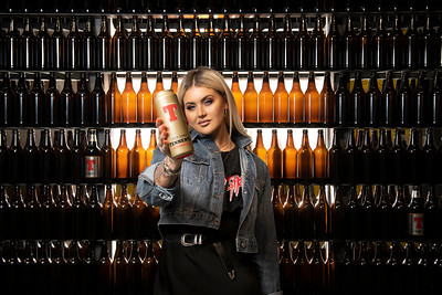 Make-up artist and entrepreneur Jamie Genevieve visits the Tennent's museum and receives a golden can  .Copyright photo Paul Chappells 07774730898 www.paulphoto.co.uk