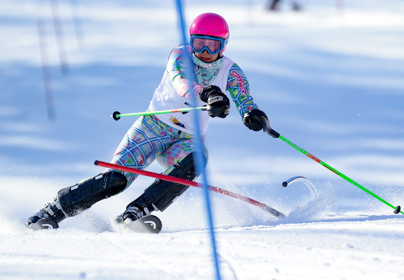 Brooke Lever slashes her way through a hairpin midway through her first run at the Class A state championship slalom event at Mt. Abram in Locke Mills. Lever went on to finish first.