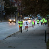 Participants in Sunday night's Glow Run 5k make their return trip down Main Street Norway.  Proceeds for the event help pay for the insurance costs of local youth sports programs sponsord by the Oxford Hills Athletic Boosters.