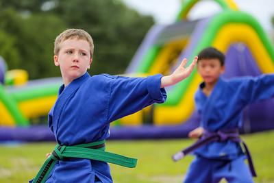 Mackenzie Pelletier of Lewiston performs Saturday with Pelletier's Karate Demonstration Team during the Summer Block Party.