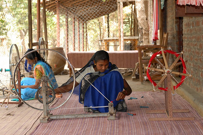"07011706 - A bicycle wheel and chains are used to make a threading machine ""Charkha""."