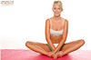 Athletic blond woman on a yoga mat