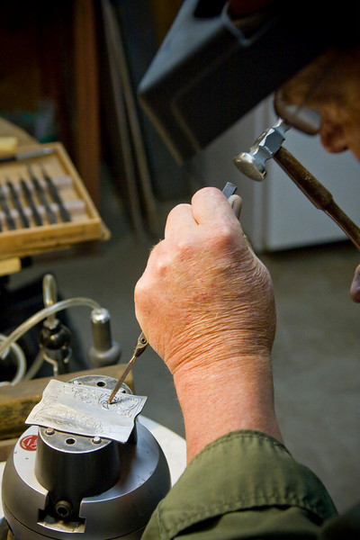 Timothy Alverson knifemaker of Clearwater Knives, demonstrates the fine art of metal engraving on a belt buckle.