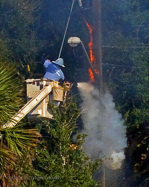 JEA worker assists the Jacksonville Fire Department with a stubborn electrical fire at Seminole and 19th in Atlantic Beach.