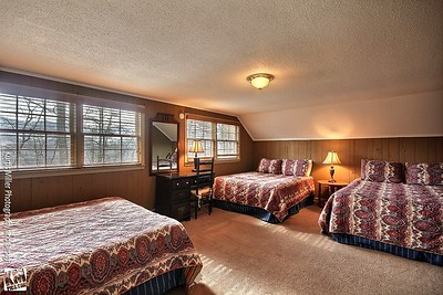 chalet number ten upstairs bedroom