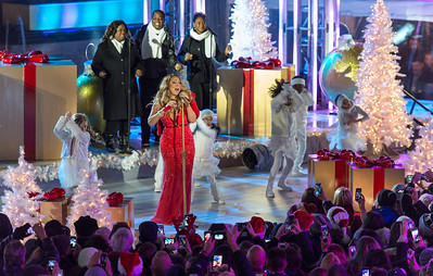 Mariah Carey performs at the 82nd Annual Rockefeller Center Christmas Tree Lighting Ceremony