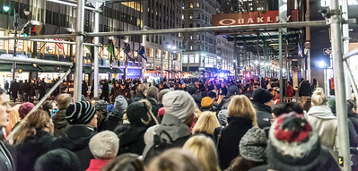 Protesters on one side of 5th Ave and crowds leaving the Christmas tree lighting on the other.