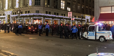 NYPD officers cordoning off protesters during the Christmas Tree lighting at the Rockefeller Center