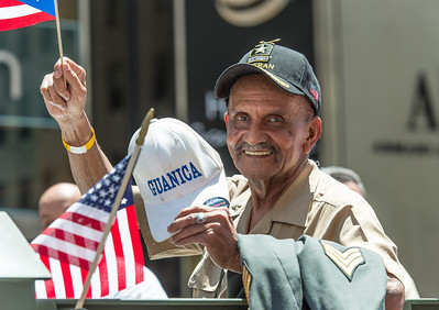 U.S Army Veteran on the National Guard Float congratulating the 65th Infantry Borinqueneers