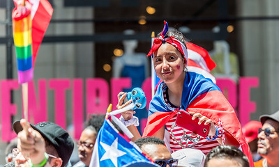 Celebrating the Puerto Rican Day Parade on Fifth Avenue.