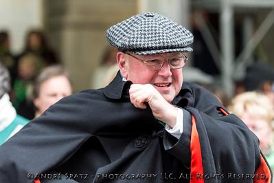 NY Cardinal Dolan setting his cape at a very cold St' Patrick's Day Parade