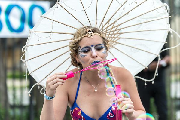 Mermaid blowing soap bubbles.