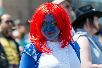 Mermaid reveler with a colorful outfit