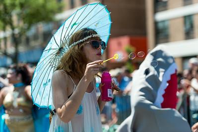 Mermaid blowing soap bubbles