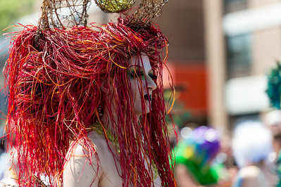 This paradegoer features amazing red sea hair