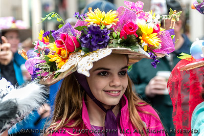 Parade participant dressed for the occasion with really fancy hats.