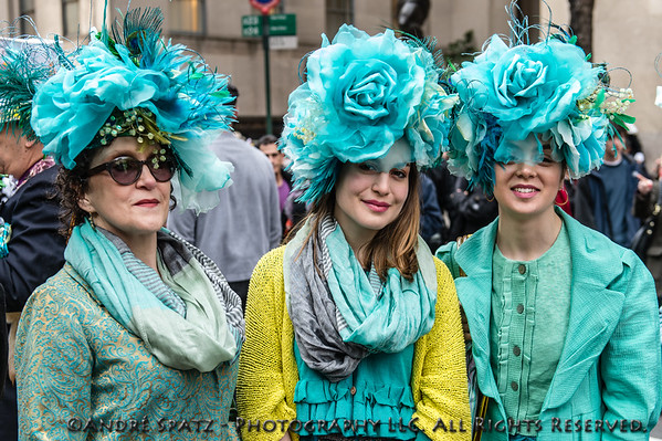 Parade participants dressed for the occasion with really fancy hats.