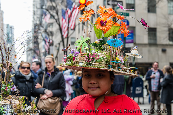 A parade participant dressed for the occasion with a really fancy hat.