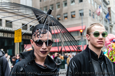 A Parade participant dressed for the occasion with really fancy hats.