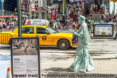 Lady Liberty character dressed for the 4th of July occasion in Times Square- Ready for pictures with the tourists.