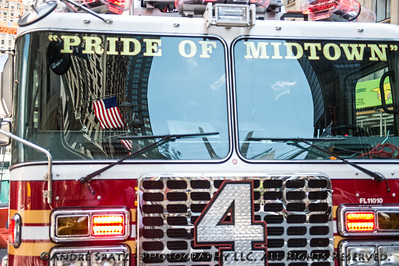"""Independence Flag reflections on FDNY Ladder No. 4  """"Pride of Manhattan"""" fire truck."""