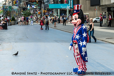 Even Disney Character Mickey Mouse is dressed for the 4th of July occasion in Times Square- Ready for pictures with the tourists.