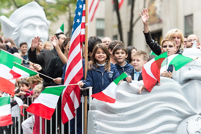 Children waving the Italian Flag on the Columbus Citizens Foundation Float
