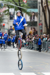 Acrobat cyclist with Gym Dandies from the Scarborough Schools, Maine - part of the red carper performes of the parade.