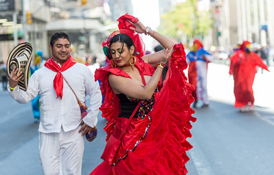 Colombian dancers in traditional outfits.