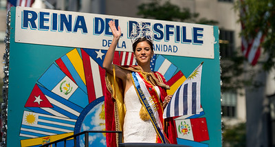 The Queen of the Parade is seen on a float with a Uruguayan flag.