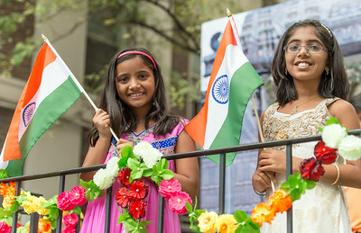 Children waiving the India Flag on the parade float