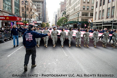 New York State National Guard carry a large flag during the annual Veterans Day Parade