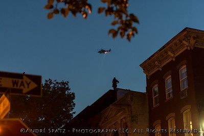 Secret Service and NYPD Helicopter  on the rooftop above Parker's brownstone.