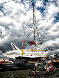 Getting ready to lift the Space Shuttle Enterprise with huge crane.