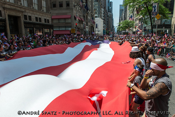 Scene from the Puerto Rican Day Parade in NYC. Huge Puerto Rican flag covering half a block on Fifth Ave.