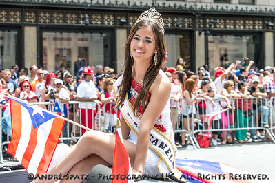 Miss Piel Canela 2012 Reina Teen - rides atop a car in the parade.