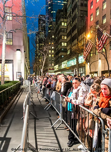 Huge crowds wait to watch the Rockefeller Tree Lighting along 5th Avenue.