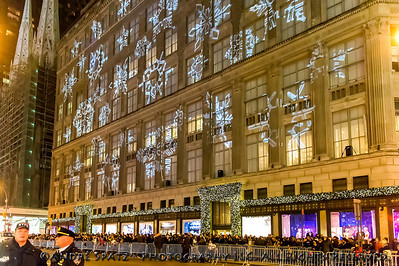 Huge crowds in front of SAKS  Deptartment Store on 5th Avenue watching The Rockefeller Center Christmas Tree lighting.