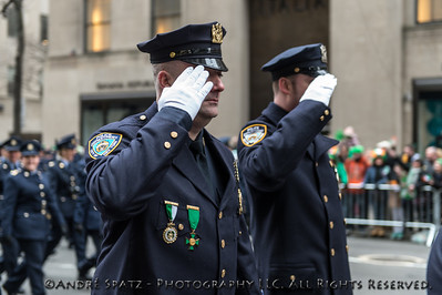 NYPD salutes in front of St. Patrick's Cathedral.
