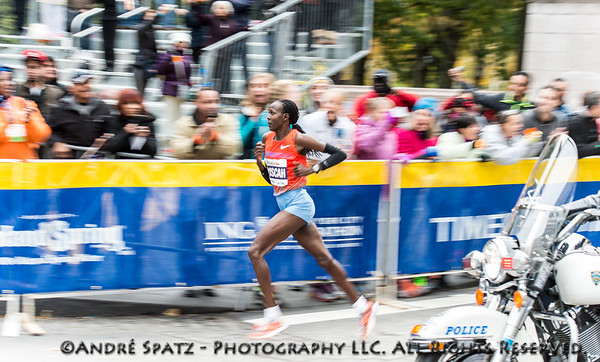 The women's winner of the NYC Marathon, 	Priscah Jeptoo from Kenya in the final finish at Columbus Circle