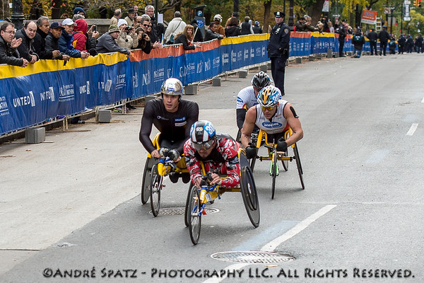 The first four wheelchair racers almost at the finish: Marcel Hug, Switzerland - Ernst Van Dyk South Africa, Kurt Fearnley,Australia Masazumi Soejima Japan