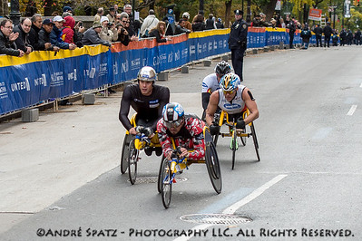 The first four wheelchair racers almost at the finish: Marcel Hug, Switzerland - Ernst Van Dyk South Africa, Kurt Fearnley,Australia Masazumi Soejima Japan