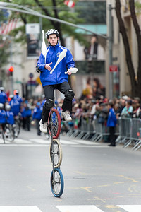 Acrobat cyclist with Gym Dandies from the Scarborough Schools, Maine - part of the red carper performes of the parade. (3)